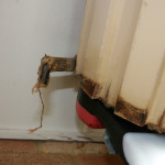 A good example of a roller door in need of a service, the roller door is rusty and has broken parts.