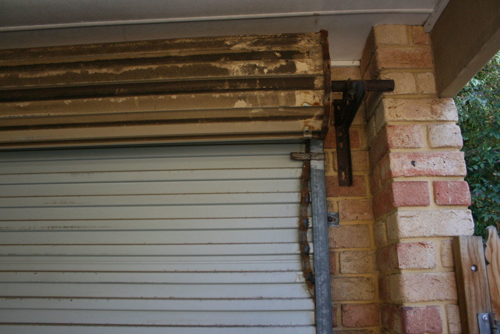 A Dirty Roller Door In Need Of A Good Service And Clean By A1 Garage Door