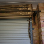 A dirty roller door in need of a good service and clean by a1 Garage door repairs perth