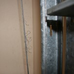 Close up of frayed Garage Door Cable requiring replacement